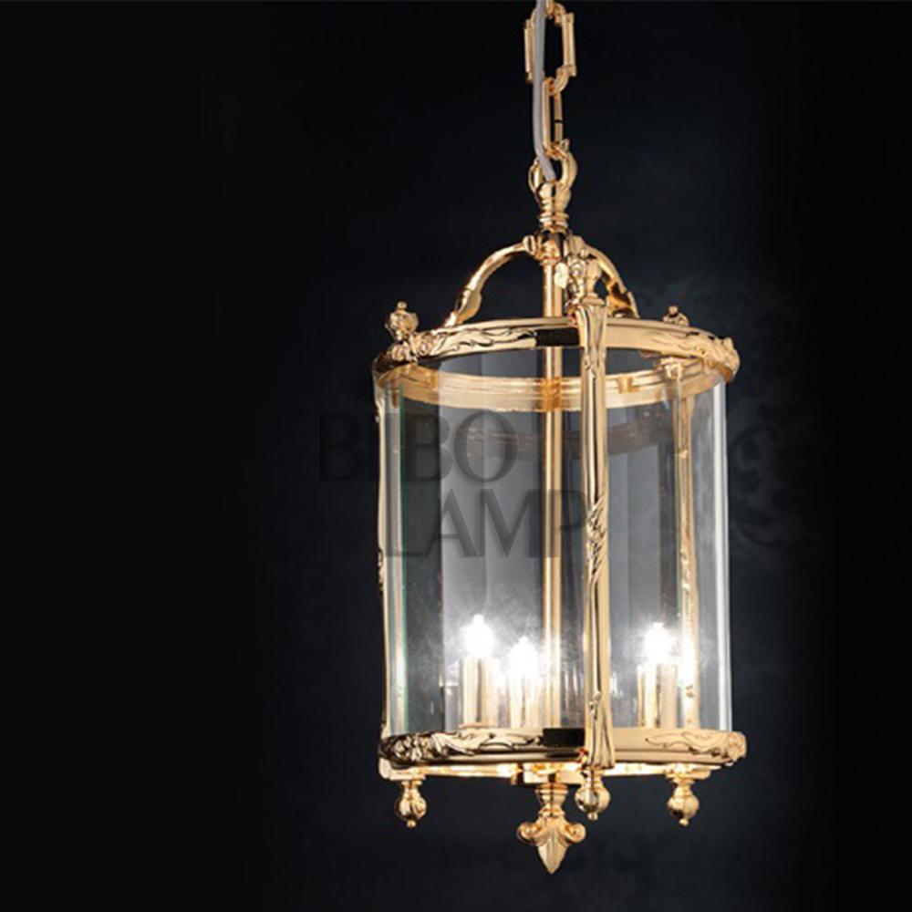 Farol de Bronce  y Cristal con acabado en Oro disponible en tres tamaños de Bilbolamp